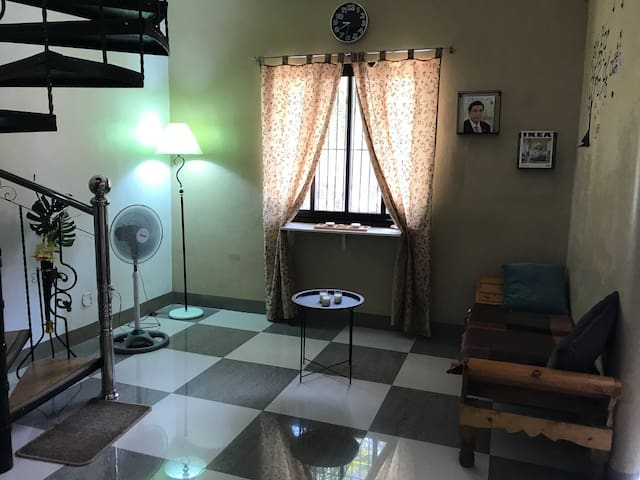 Living room Space  for a singel bed with deluxe bed matress for a comfortable sleep with electricfan. Ground floor.