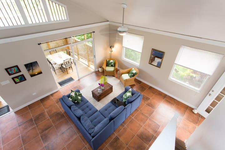 Looking down to the living room from the loft.