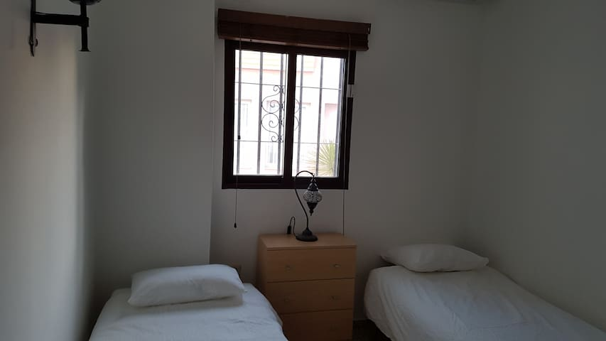 Bedroom 2 with twin beds that can be adjoined, large closet.