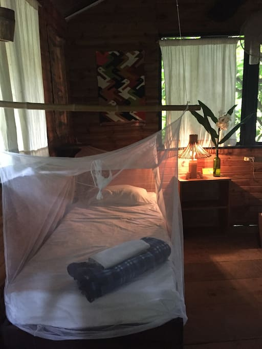 Inside the tree house. The single bed.