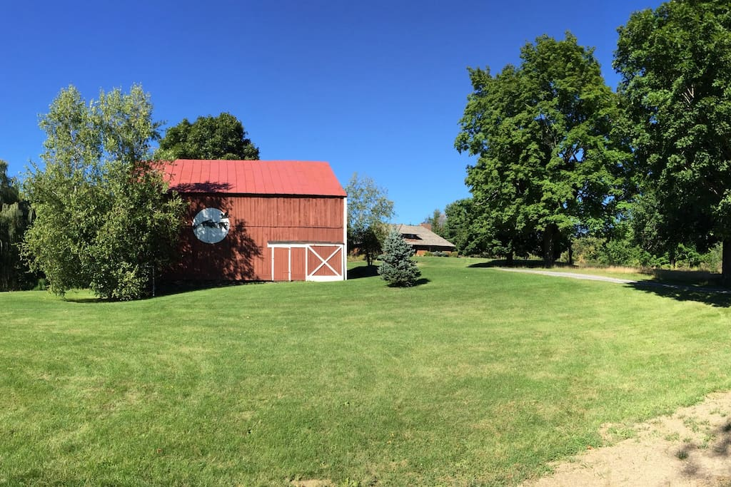 Looking up at the barn and house from little pond.
