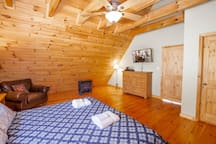 Upstairs Master Suite with Custom-crafted King Bed, Vaulted Ceilings and Exposed Beams
