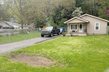 Front house, front yard, fenced in yard and drive