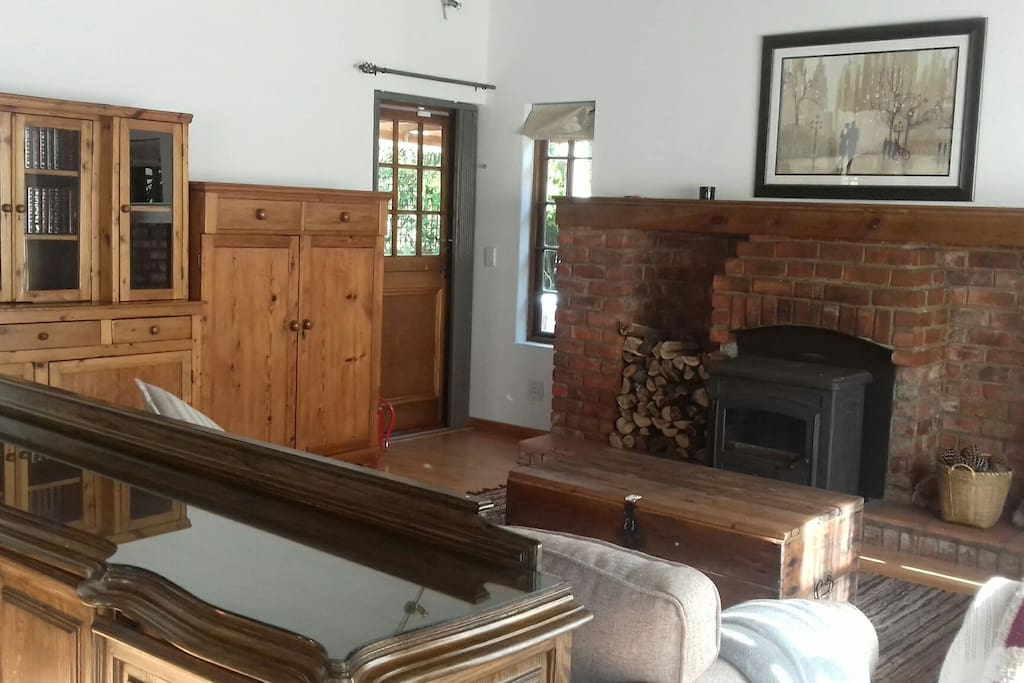 Lounge with superb fireplace and doors to the garden.