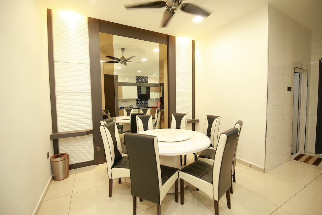 Classy dining area, a luxurious marble table and a cheerful night full of laughter.