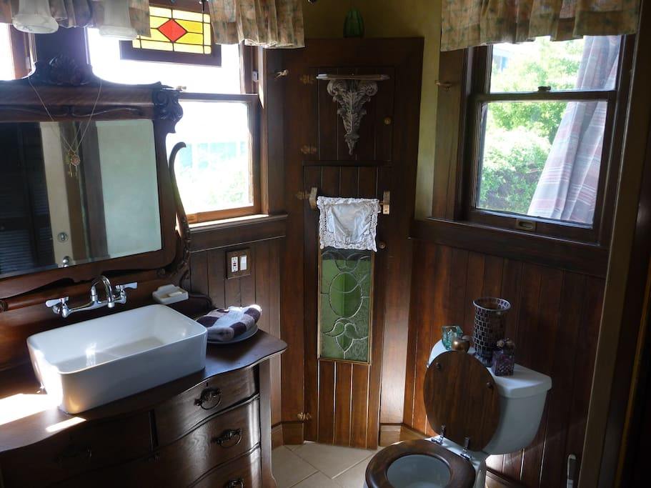 Arts and Crafts Style Bathroom bathed in natural light.