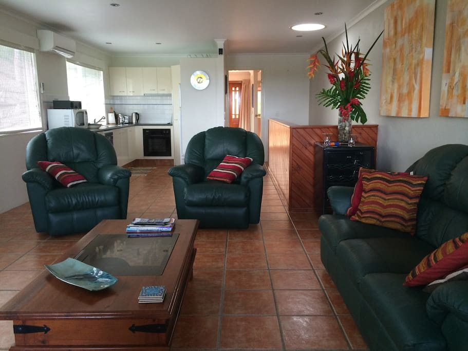 Upstairs lounge room looking towards the main bedroom and the balcony outside.