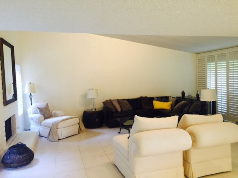 Spacious living room with    55 inch television and blue ray player...