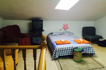 Big sofa in attic room.  - Manises