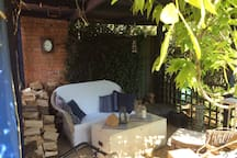 Relax in the wisteria covered garden room.