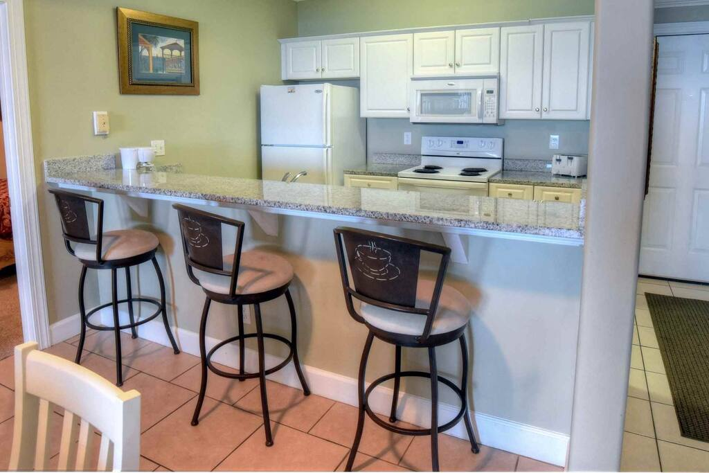 Fully equipped kitchen with plenty of seating!