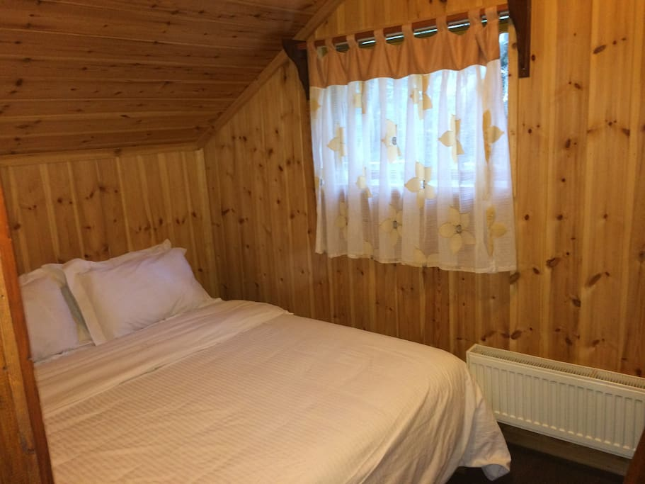 This bedroom has a double bed that can be separated