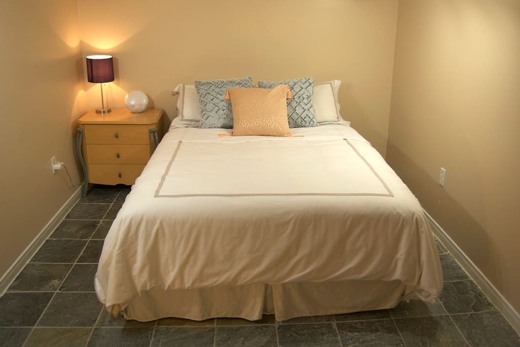 Cozy, quiet bedroom near the bathroom. All the clean towels you can handle!