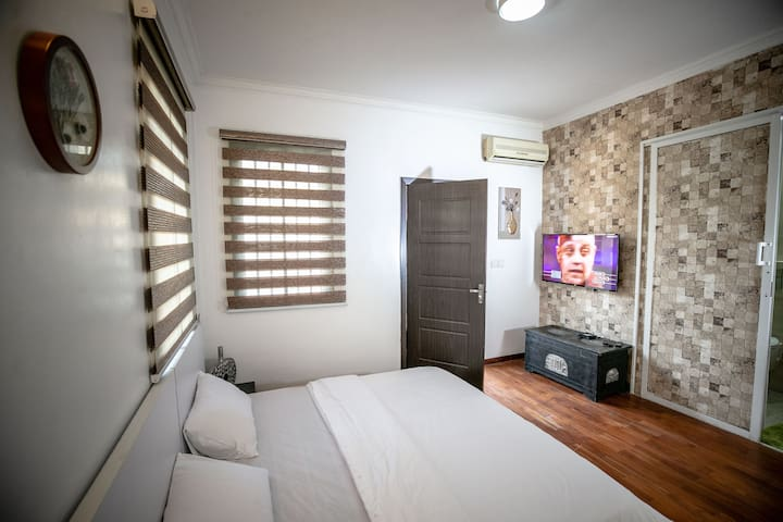 Master bedroom (ensuite) with TV & its own decoder box