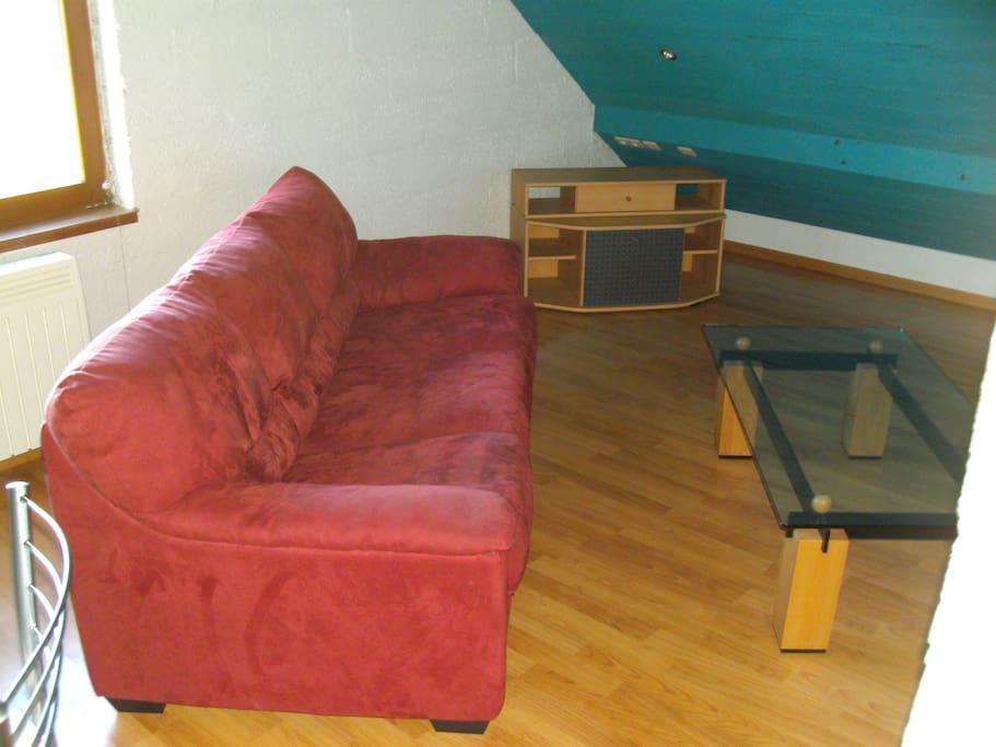 Canapé lit confortable.