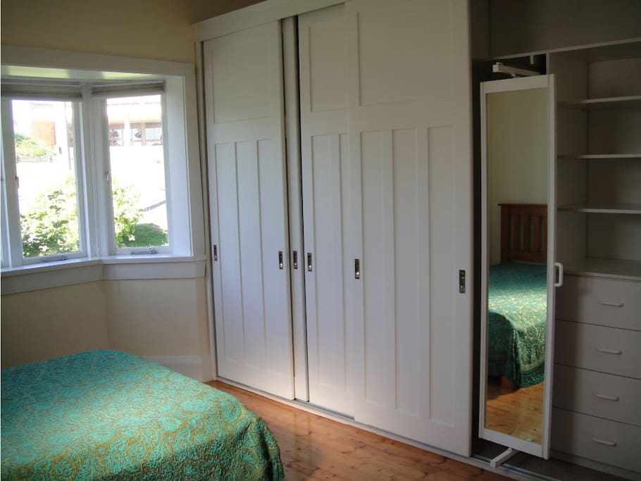 walk-in wardrobe with full-length swivel mirror