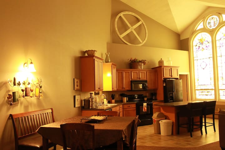 Each suite features 24 foot high ceilings, original stained glass, stocked kitchen & cozy living space with gas fireplace