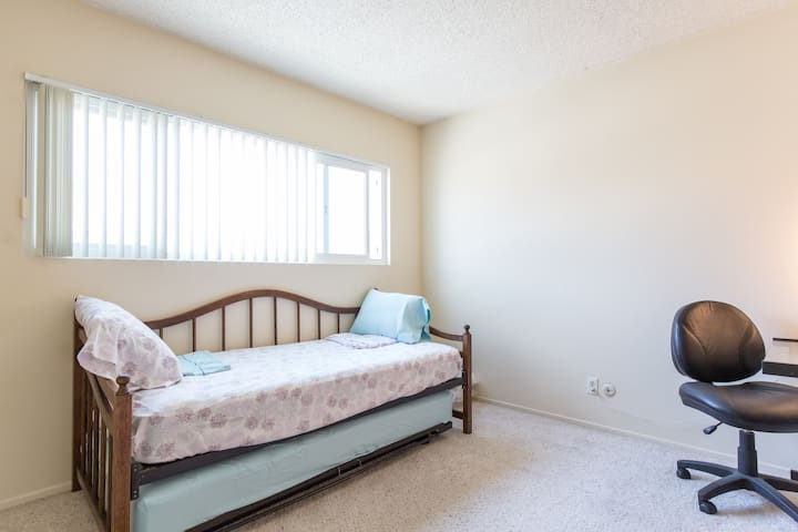 second/back bedroom with trundle bed (2 twin mattresses) and desk