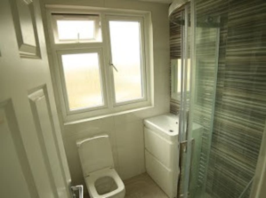 Shower room, toilet and wash basin on top floor attached to loft room(Sleep for 4)