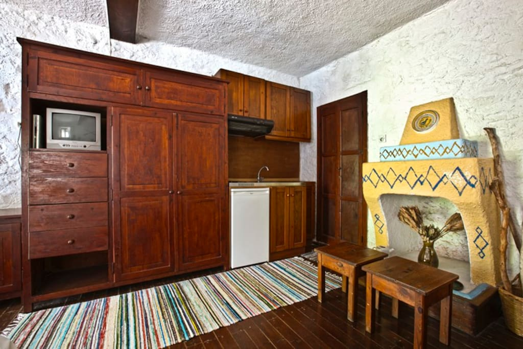 the kitchenette and the fireplace
