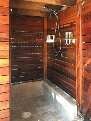 There is a spectacular outdoor sunken shower right outside your door.