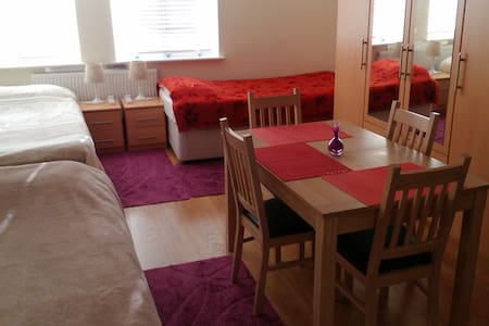Spacious triple room with many amenities