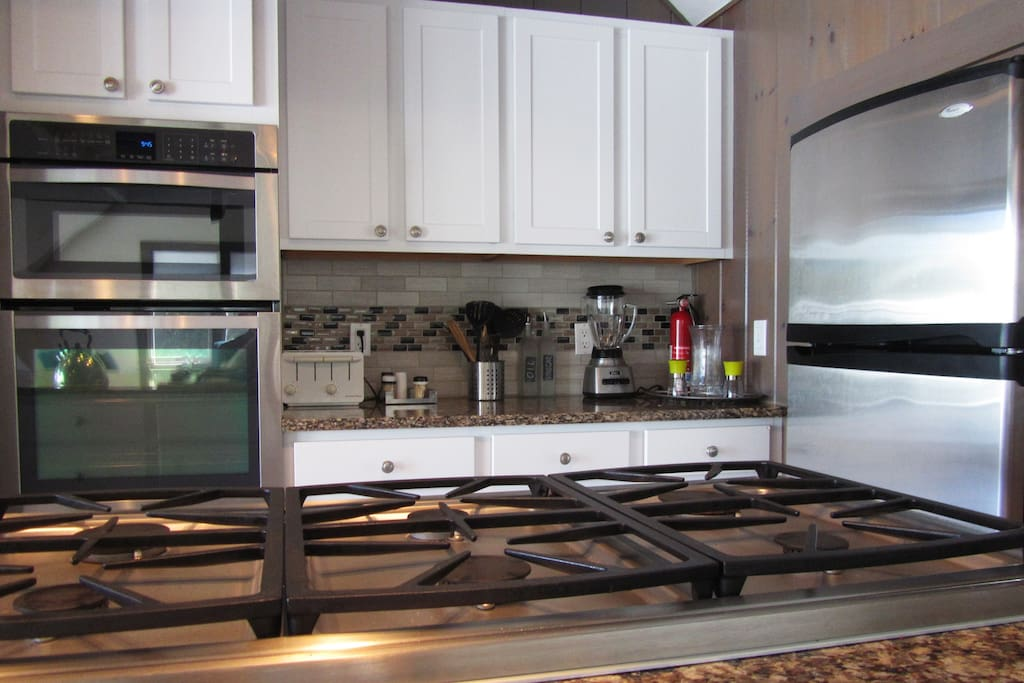 Chef's kitchen: Six burner gas stove, electric oven. Great space to cook for a group.