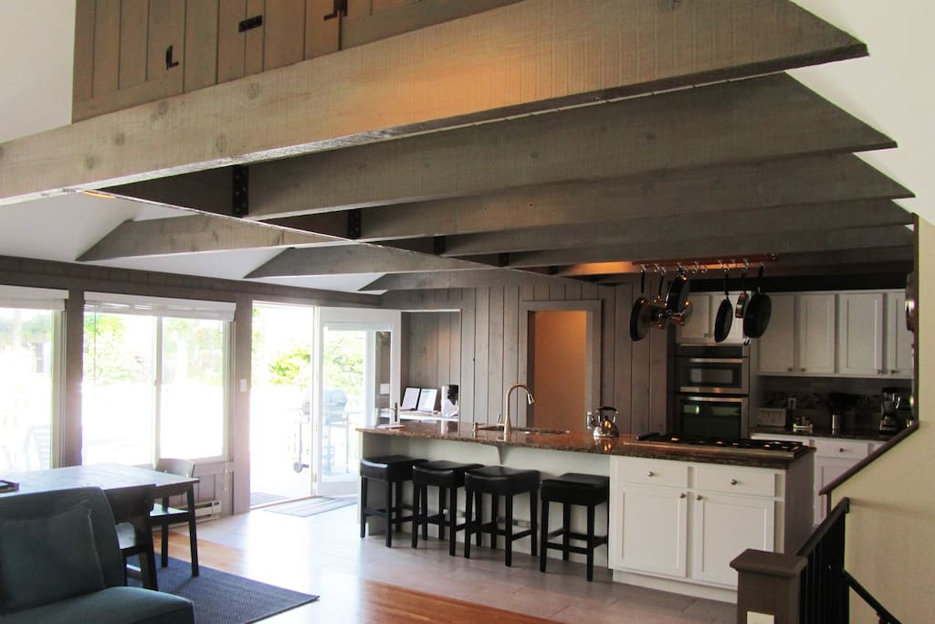 What a wonderful gathering space! This is the kitchen portion of Great Room with sliders to the deck.