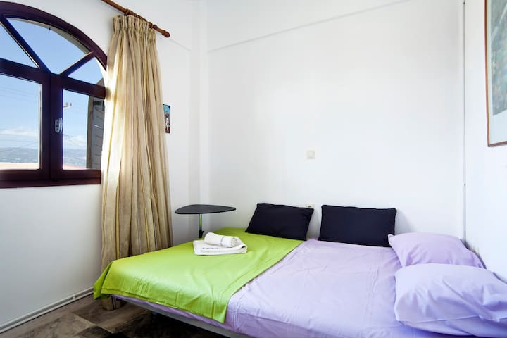 This is the second bedroom. It has  a large double double bed that can easily accomodate 2 more guests or a child.
