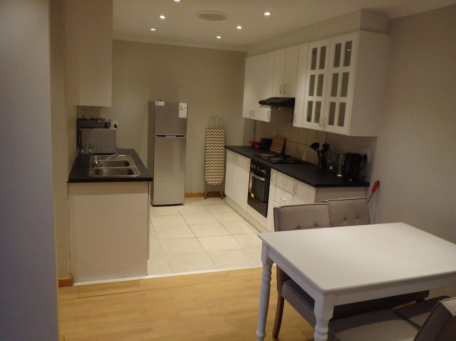 All new appliances in the kitchen and a comfortable table for four.