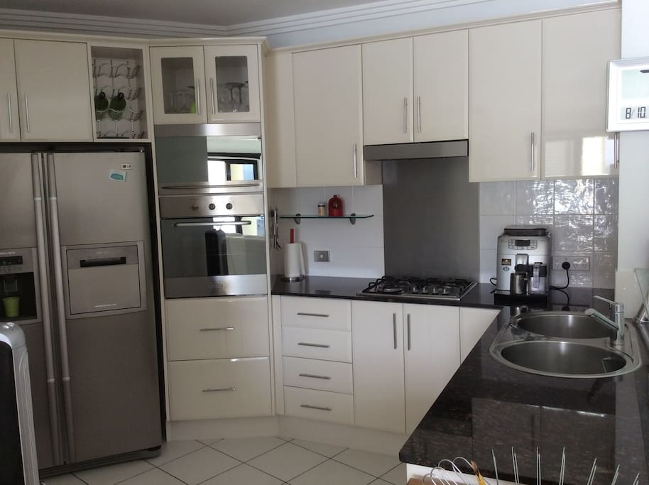 The well appointed kitchen has all amenities, including dishwasher, microwave, all cutlery and crockery and ice at the push of a button.