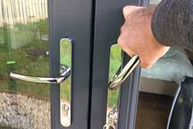 Remember non UK folk that you need to lift handle to lock the doors. This sets the bolts in place and the key will turn smoothly if you lift and then CLICK a little more to lock.