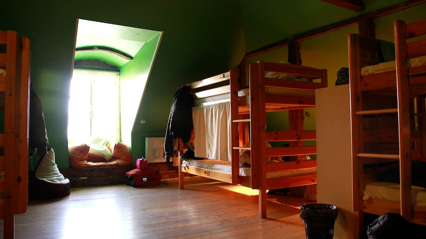 A dorm bed in Travellers house
