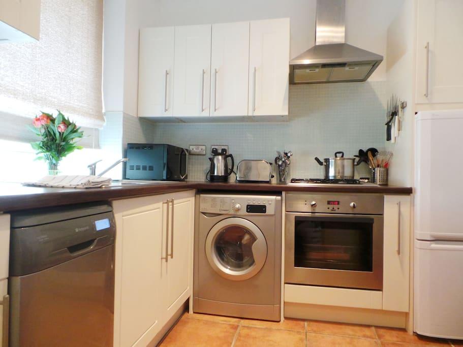 The kitchen with dishwasher, fridge freezer and washer/dryer