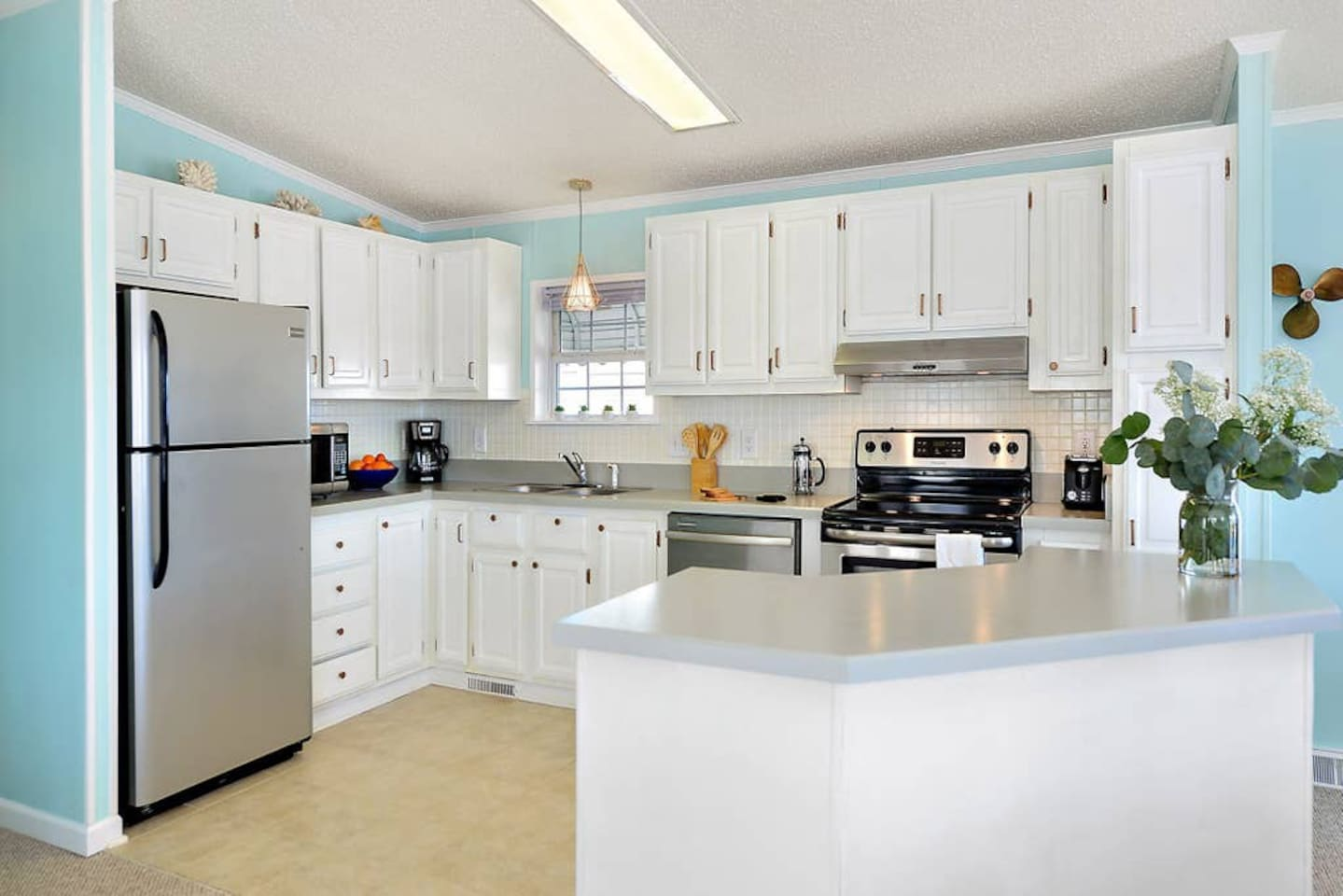 Large, newly renovated, open concept kitchen with stainless steal appliances, lots of counter space and great views of the bay as you cook your meals at home!