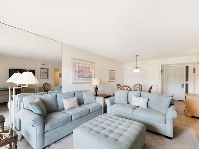 The living room in 1723 Bluff Villa includes a new Queen sleeper sofa and flat panel TV