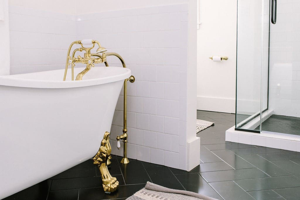 The bathroom in Suite A include a claw foot bathtub and walk in shower.