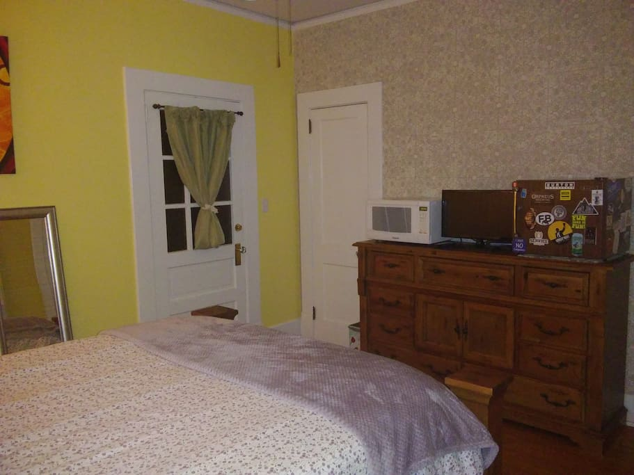 Guest Bedroom - Private entrance, microwave, TV, and refrigerator