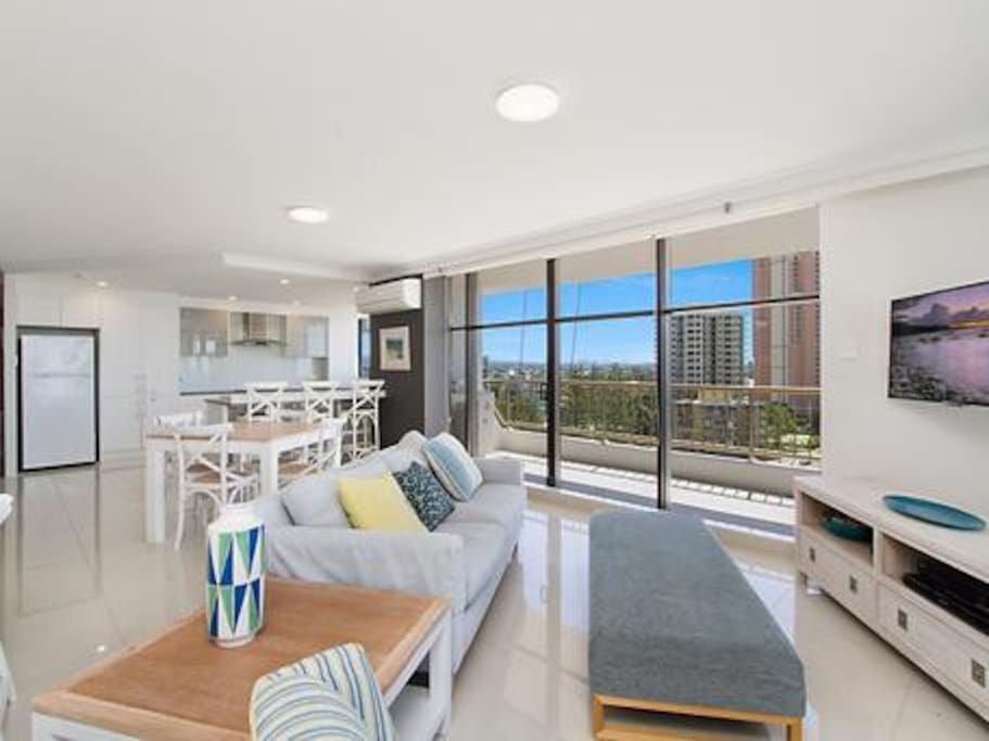 Open plan living space between large kitchen and lounge area. One side looks straight out to ocean - other has great night views to Surfers Paradise