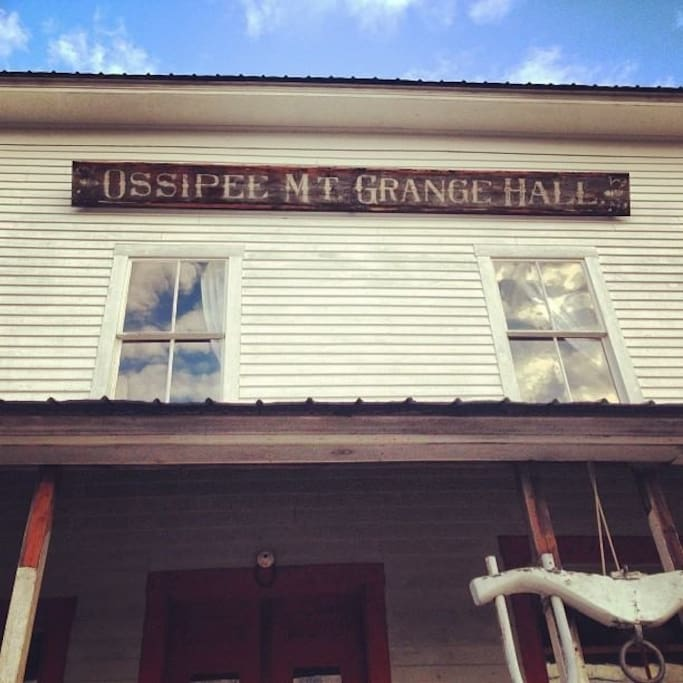 The original sign of the Ossipee Mountain Grange Hall