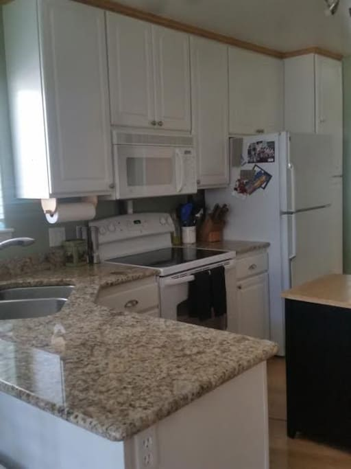 Kitchen with newer appliances & granite counter tops
