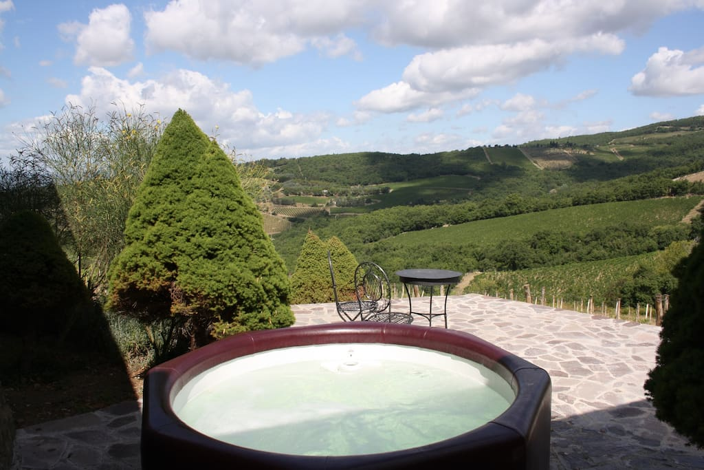 Private heated jacuzzi with the view of the vineyard, on the third terrace of the cottage