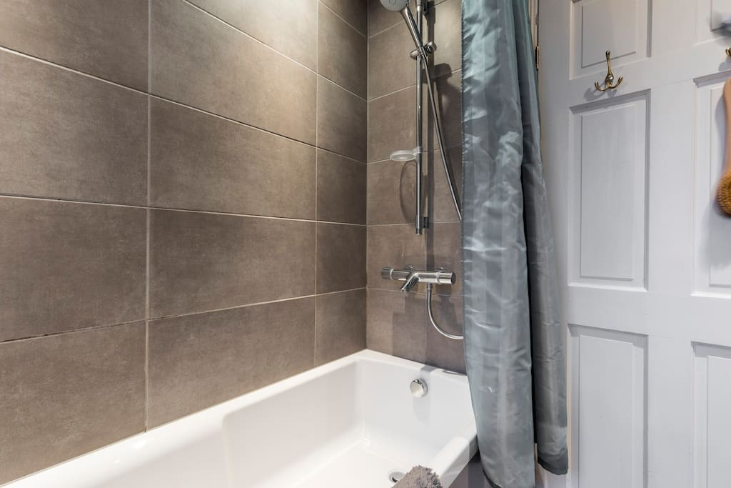 Luxurious contemporary  bathroom, with Grohe fittings, bath, power shower and heated towel rail.