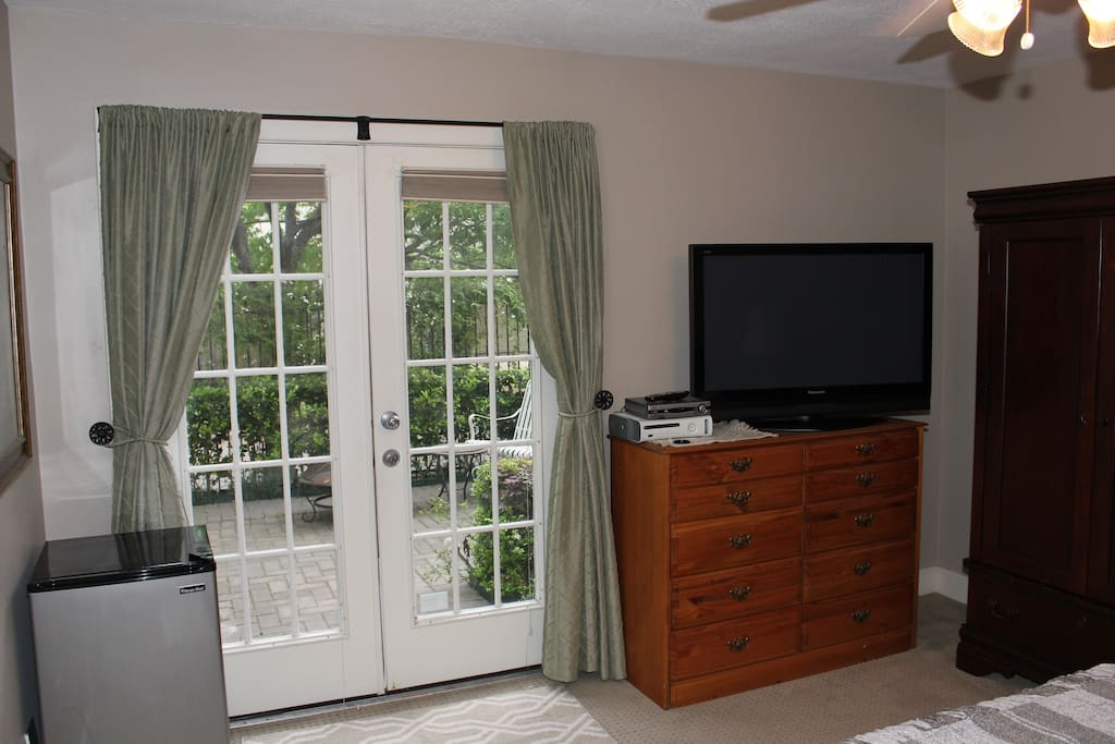 Television, dresser and refrigerator.