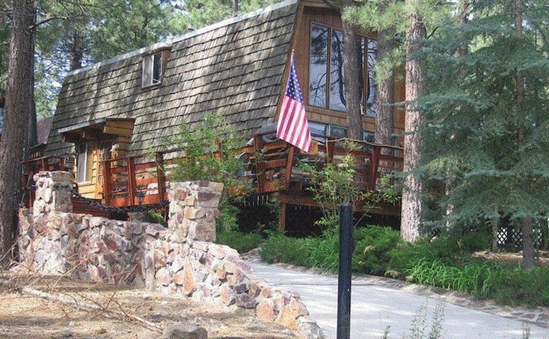 Big Bear Cabin Nestled Among Tall Pine Trees