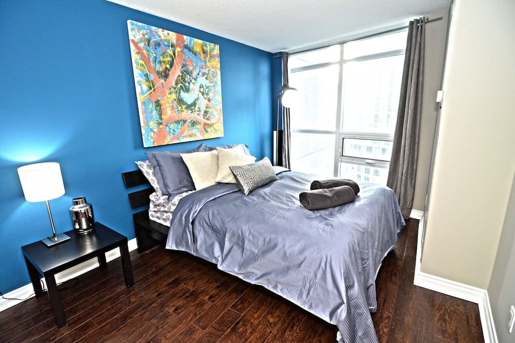 Large master bedroom with plenty of closet space, a queen size bed and a full ensuite bathroom