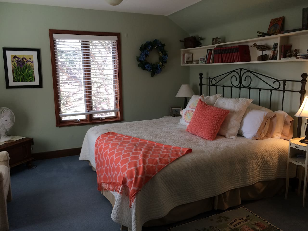 Large bedroom has windows on 3 sides and private full bath.