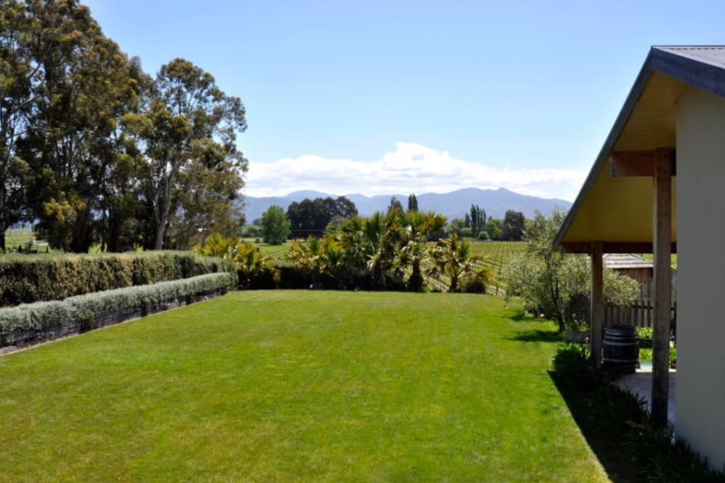 Set amongst mature trees and looking out over our small, family vineyard, with expansive views across the valley to the Richmond Ranges.