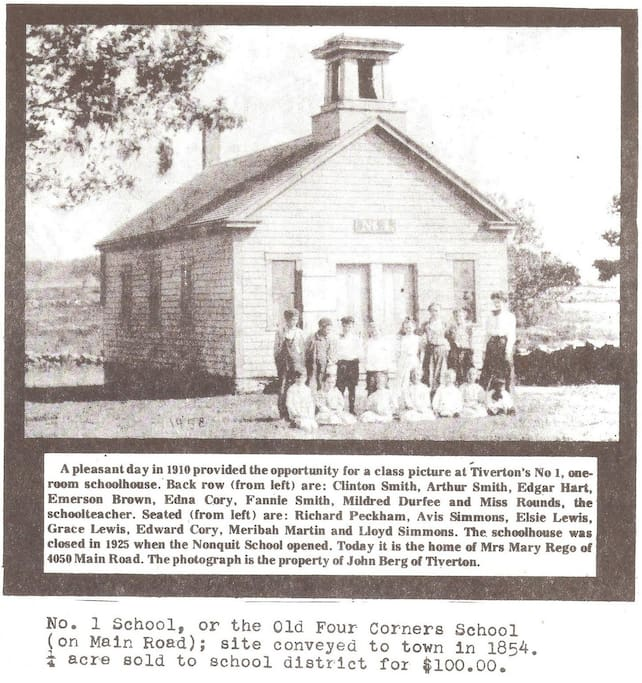 Historic photo depicting the schoolhouse and students aprox 1900