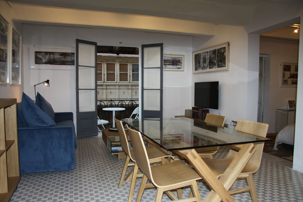 gallery living, dining, TV area onto open balcony